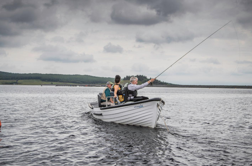small fishing boat with angler casting a line